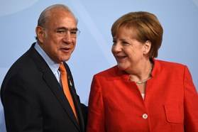 OECD Secretary-General Angel Gurría with German Chancellor Angela Merkel at the G20 Summit 2017 in Hamburg;
